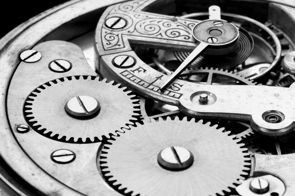 antique clock machinery, black and white pihoto